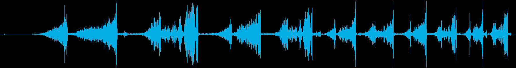 DJがレコードを巻き戻した音の再生済みの波形