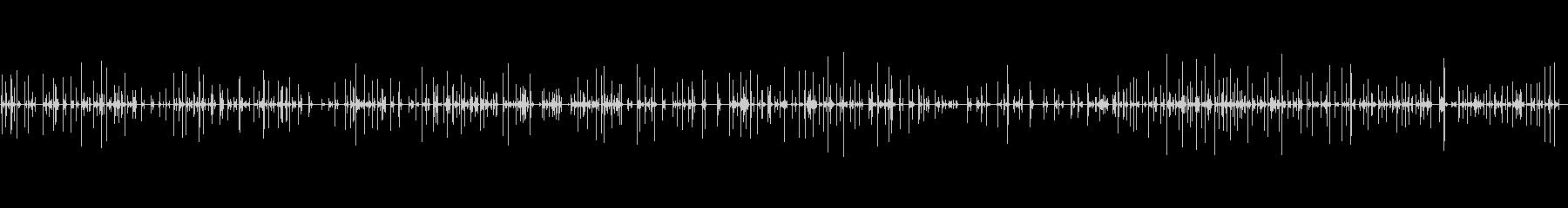 コンピューターのキーボードで入力する人の未再生の波形